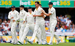 Australia's Mitchell Starc celebrates with team mates after dismissing England's Dawid Malan during day two of the Ashes Test match at The Gabba, Brisbane.