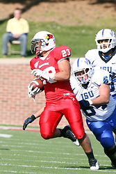 22 October 2011: Adam Masters dives for Austin Davis during an NCAA football game  the Indiana State Sycamores lost to the Illinois State Redbirds (ISU) 17-14 at Hancock Stadium in Normal Illinois.