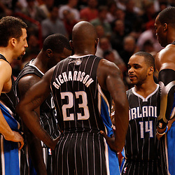 March 3, 2011; Miami, FL, USA; Orlando Magic players huddle up to talk during the third quarter against the Miami Heat at the American Airlines Arena. The Magic defeated the Heat 99-96.    Mandatory Credit: Derick E. Hingle