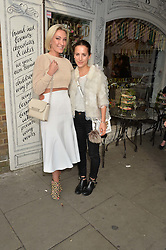Left to right, OLIVIA BUCKINGHAM and EMMA REEVE at a party to launch Biscuiteers Fashion Biscuit Collection inspired by Alice Naylor-Leyland's wardrobe held at Biscuiteers, 194 Kensington Park Road, London W11 on 23rd June 2015.
