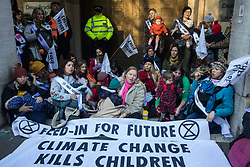 London, UK. 2 December, 2019. Climate activist mothers from Extinction Rebellion Families nurse their babies outside the headquarters of the Brexit Party as part of a roving nurse-in outside the premises of the various political parties to demand that they put the climate and ecological emergency at the heart of their general election campaigns.