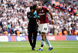 Aston Villa's Tyrone Mings comes off injured during the Sky Bet Championship Play-off final at Wembley Stadium, London.