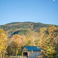 The moon rises as the sun sets on Mt Ascutney and over Bower Covered Bridge in W Windsor, Vermont.  All Content is Copyright of Kathie Fife Photography. Downloading, copying and using images without permission is a violation of Copyright.