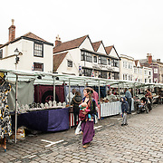 Stalls at a street market in Market Place in the center of Wells, Somerset, near Wells Cathedral.