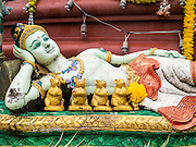 """29 SEPTEMBER 2012 - NAKORN NAYOK, THAILAND: A statue of Shiva, Ganesh' mother, at Wat Utthayan Ganesh, a temple dedicated to Ganesh in Nakorn Nayok, about three hours from Bangkok. Many Thai Buddhists incorporate Hindu elements, including worship of Ganesh into their spiritual life. Ganesha Chaturthi also known as Vinayaka Chaturthi, is the Hindu festival celebrated on the day of the re-birth of Lord Ganesha, the son of Shiva and Parvati. The festival, also known as Ganeshotsav (""""festival of Ganesha"""") is observed in the Hindu calendar month of Bhaadrapada, starting on the the fourth day of the waxing moon. The festival lasts for 10 days, ending on the fourteenth day of the waxing moon. Outside India, it is celebrated widely in Nepal and by Hindus in the United States, Canada, Mauritius, Singapore, Thailand, Cambodia, Burma , Fiji and Trinidad & Tobago.     PHOTO BY JACK KURTZ"""