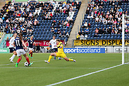 Natalia Voskobovich (#1) of Belarus rushes out to block the shot from Lisa Evans (#11) of Scotland during the FIFA Women's World Cup UEFA Qualifier match between Scotland Women and Belarus Women at Falkirk Stadium, Falkirk, Scotland on 7 June 2018. Picture by Craig Doyle.