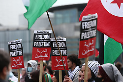© Licensed to London News Pictures. 29/05/2021. Salford, UK.  Protesters hold up signs at a 'Protest for Palestine' outside the BBC studios in Media City. Pro-Palestine demonstrations have been taking place worldwide in the wake of Israel's 11 day bombardment of Gaza which resulted in hundreds of civilian deaths. Photo credit: Adam Vaughan/LNP