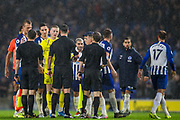 Players thanking the officials following the Premier League match between Brighton and Hove Albion and Everton at the American Express Community Stadium, Brighton and Hove, England on 26 October 2019.