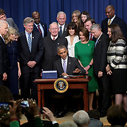 President Barack Obama signs the 21st Century Cures Act during a ceremony in the South Court Auditorium at the White House on Tuesday, December 13, 2016.