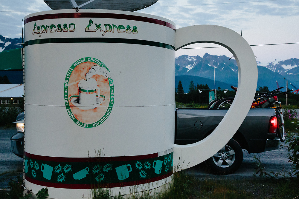 The coffee cup shaped building of Espresso Simpatico during early morning in Seward, Alaska.