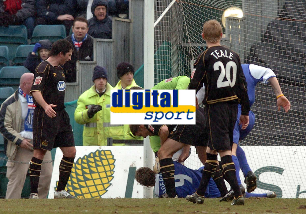 Picture: Henry Browne.<br /> Date: 26/02/2005.<br /> Gillingham v Wigan Athletic Coca Cola Championship.<br /> Darius Henderson of Gills is picked on by Wigan keeper John Filan - they were both booked for their troubles.
