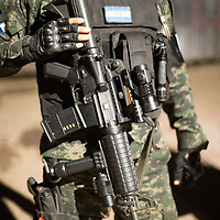A well-equiped military Policeman on night patrol in Tegucigalpa