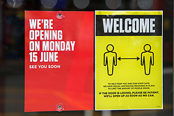 "© Licensed to London News Pictures. 14/06/2020. London, UK. 'WE""RE OPENING ON MONDAY 15 JUNE' and a ""WELCOME' sign on the window of Ladbrokes in north London, which will reopen on 15 June as coronavirus lockdown restrictions are eased. The government has announced that all betting shops can re-open on Monday 15 June. Betting shops were closed late March following outbreak of COVID-19. Photo credit: Dinendra Haria/LNP"