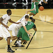 Marshall forward Johnny Thomas (0) gets fouled by Central Florida center Tom Herzog (41) during a Conference USA NCAA basketball game between the Marshall Thundering Herd and the Central Florida Knights at the UCF Arena on January 5, 2011 in Orlando, Florida. Central Florida won the game 65-58 and extended their record to 14-0.  (AP Photo/Alex Menendez)