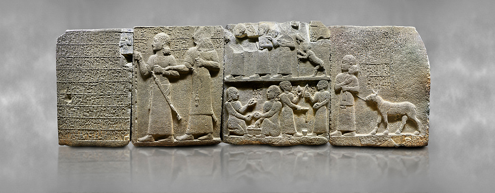 """Hittite monumental relief sculpted orthostat stone panel of Royal Buttress. Basalt, Karkamıs, (Kargamıs), Carchemish (Karkemish), 900-700 B.C. Anatolian Civilisations Museum, Ankara, Turkey.<br /> <br /> Hieroglyph panel1 (left) - Discourse of Yariris. Yariris presents his predecessor, the eldest son Kamanis, to his people. <br /> Second From left panel 2  -  King Araras holds his son Kamanis from the wrist. King carries a sceptre in his hand and a sword at his waist while the prince leans on a stick and carries a sword on his shoulder. <br /> Hieroglyphs reads; """"This is Kamanis and his siblings.) held his hand and despite the fact that he is a child, I located him on the temple. This is Yariris' image"""".  <br /> <br /> Panel 3 - This panels scene showing 8 out of 10 children of the King, the hieroglyphs reads as follows: """"Malitispas, Astitarhunzas, Tamitispas,Isikaritispas, Sikaras, Halpawaris, Ya hilatispas"""". Above, there are three figures holding knucklebones (astragalus) and one figure walking by leaning on a stick; below are two each figures playing the knucklebones and turning whirligigs.<br />  <br /> Panel 4 - The queen carries her youngest son. The hieroglyphs located above read; """"and this is Tuwarsais; the prince desired by the ruler, whose exclusiveness has been exposed"""". While the queen carries her son in her lap, she holds the rope of the colt coming behind with her other hand. The muscles of the colt are schematic. <br /> <br /> Against a grey art background. .<br />  <br /> If you prefer to buy from our ALAMY STOCK LIBRARY page at https://www.alamy.com/portfolio/paul-williams-funkystock/hittite-art-antiquities.html  - Type  Karkamıs in LOWER SEARCH WITHIN GALLERY box. Refine search by adding background colour, place, museum etc.<br /> <br /> Visit our HITTITE PHOTO COLLECTIONS for more photos to download or buy as wall art prints https://funkystock.photoshelter.com/gallery-collection/The-Hittites-Art-Artefacts-Antiquities-Historic-Sites-Pictures-Images"""
