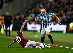 Aaron Mooy of Huddersfield Town Manuel Lanzini of West Ham United - Mandatory by-line: Phil Chaplin/JMP - 16/03/2019 - FOOTBALL - London Stadium - London, England - West Ham United v Huddersfield Town - Premier League
