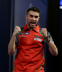 Jamie Lewis celebrates beating James Richardson during day twelve of the William Hill World Darts Championship at Alexandra Palace, London. PRESS ASSOCIATION Photo. Picture date: Thursday December 28, 2017. See PA story DARTS World. Photo credit should read: Steven Paston/PA Wire. RESTRICTIONS: Use subject to restrictions. Editorial use only. No commercial use.