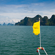 Yellow flag of a ferry in the national park of Phang Nga, Thailand