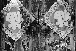 Detail of old door with Chinese New Year decorations in a Beijing hutong