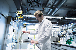Young male scientist working in a pharmacy laboratory, Freiburg Im Breisgau, Baden-Wuerttemberg, Germany