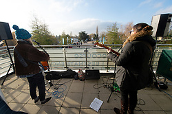 Taylor and The Mason perform at the Centaur entrance at Cheltenham Racecourse