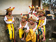 19 JULY 2016 - TAMPAKSIRING, GIANYAR, BALI, INDONESIA:  Dancers wait to perform on the first day of a ceremony to honor the anniversary Pura Agung temple, one of the most important Hindu temples on Bali. This year's ceremony is the most important in years because it falls on the 50 year cycle of the temple's founding. This year's ceremony lasts for 11 days.     PHOTO BY JACK KURTZ
