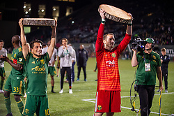 June 15, 2018 - Portland, Oregon, U.S. - PORTLAND, OR - JUNE 15:  Portland Timber players Sebasti‡n Blanco (left) and Jeff Attinella (right) lift their trophies for their goal and clean sheet at the end of the Portland Timbers game versus the LA Galaxy in a United States Open Cup match on June 15, 2018, at Providence Park, OR. (Photo by Diego G Diaz/Icon Sportswire) (Credit Image: © Diego Diaz/Icon SMI via ZUMA Press)