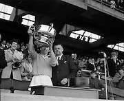 04/10/1970<br /> 10/04/1970<br /> 10 April 1970<br /> All-Ireland Intermediate Hurling Final: Antrim v Warwickshire at Croke Park, Dublin.<br /> Antrim Captain, Sean Burns, holds up the cup.