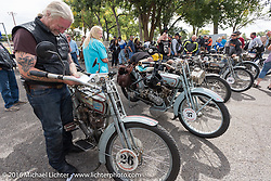 Thomas Trapp, owner of the Harley-Factory Frankfurt dealership in Germany adjusts his roll chart with the afternoon directions on his 1916 Harley-Davidson after te lunch stop in an Alamosa park during the Motorcycle Cannonball Race of the Century. Stage-10 ride from Pueblo, CO to Durango, CO. USA. Tuesday September 20, 2016. Photography ©2016 Michael Lichter.