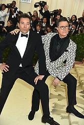 JImmy Fallon and Steven Colbert attend the Costume Institute Benefit at the Metropolitin Museum of Art at the opening of Heavenly Bodies: Fashion and the Catholic Imagination on May 7, 2018 in New York, New York, USA.
