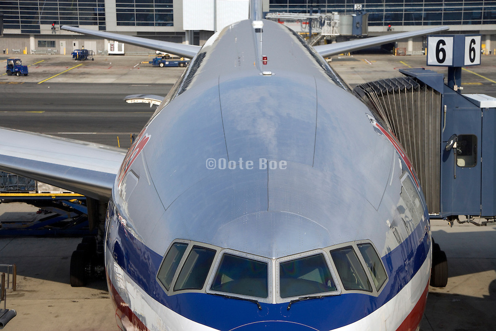An American Airlines airplane docked at the arrival and departure gate JFK airport