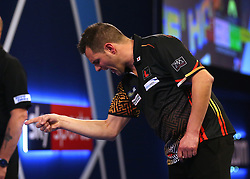 Toni Alcinas celebrates winning his match against Craig Ross during day three of the William Hill World Darts Championships at Alexandra Palace, London.