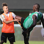 Mario Balotelli, (right) and Stephan El Shaarawy during a light hearted altercation during training with AC Milan in preparation for the Guinness International Champions Cup tie with Chelsea at MetLife Stadium, East Rutherford, New Jersey, USA.  3rd August 2013. Photo Tim Clayton