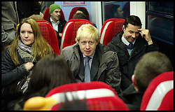 London Mayor Boris Johnson on the train back to London after Campaigning in Feltham, West London, for the By-Election with Mark Bowen the Conservative Party Candidate, Tuesday December 13, 2011 Photo By Andrew Parsons/ i-Images