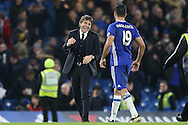 Antonio Conte, the Chelsea manager celebrates with Diego Costa of Chelsea after the final whistle. Premier league match, Chelsea v Stoke city at Stamford Bridge in London on Saturday 31st December 2016.<br /> pic by John Patrick Fletcher, Andrew Orchard sports photography.