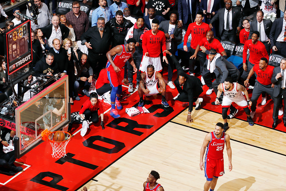 TORONTO, CANADA - MAY 12: Kawhi Leonard #2 of the Toronto Raptors hits the game-winning shot against the Philadelphia 76ers during Game Seven of the Eastern Conference Semifinals of the 2019 NBA Playoffs on May 12, 2019 at the Scotiabank Arena in Toronto, Ontario, Canada. NOTE TO USER: User expressly acknowledges and agrees that, by downloading and or using this Photograph, user is consenting to the terms and conditions of the Getty Images License Agreement. Mandatory Copyright Notice: Copyright 2019 NBAE (Photo by Mark Blinch/NBAE via Getty Images)