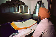 Sikh temple, Yuba City, California. Reading the Sikh holy book from start to finish during a festival.