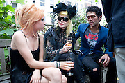 SCARLETT CARLOS-CLARKE; PAM HOGG; TIM NOBLE, Sebastian Horsley funeral. St. James's church. St. James. London afterwards in the church garden. July 1 2010. -DO NOT ARCHIVE-© Copyright Photograph by Dafydd Jones. 248 Clapham Rd. London SW9 0PZ. Tel 0207 820 0771. www.dafjones.com.