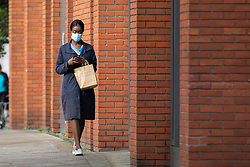 © Licensed to London News Pictures. 20/10/2020. Manchester, UK. A woman wears a face mask in central Manchester. Manchester is expecting to be forced in to a Tier 3 lockdown unless a deal is agreed, which could see businesses such as pubs and bars closed. Photo credit: Kerry Elsworth/LNP