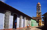 23 JULY 2002 - TRINIDAD, SANCTI SPIRITUS, CUBA: Architecture in the colonial city of Trinidad, province of Sancti Spiritus, Cuba, July 23, 2002. Bell tower in the background is the Museo de la Lucha Contra Los Bandidos, (Museum of the Struggle Against the Bandits) on Calle Fernando Hernandez Echerri. Trinidad is one of the oldest cities in Cuba and was founded in 1514. .PHOTO BY JACK KURTZ