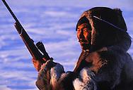 Inuit hunter Thomas Nutararearq in Caribou skin clothes, Canada