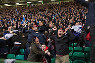 Home supporters reacting with delight as their team take the lead during the second-half of the European Championship qualifying match between Scotland and the Republic of Ireland at Celtic Park, Glasgow. Scotland won the match by one goal to nil, scored by Shaun Maloney 16 minutes from time. The match was watched by 55,000 at Celtic Park, the venue chosen to host the match due to Hampden Park's unavailability following the 2014 Commonwealth Games.