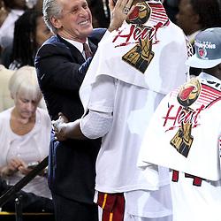 Jun 21, 2012; Miami, FL, USA; Miami Heat president Pat Riley celebrates with power forward Chris Bosh (1) after winning the 2012 NBA championship against the Oklahoma City Thunder at the American Airlines Arena. Miami won 121-106. Mandatory Credit: Derick E. Hingle-US PRESSWIRE