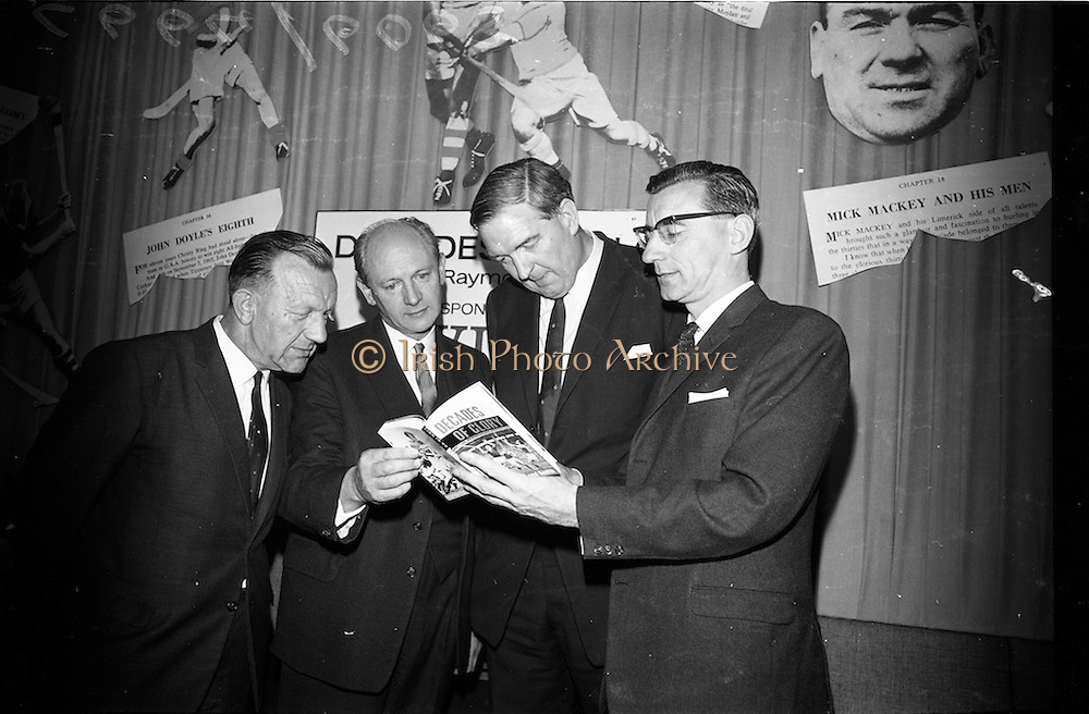 """17/05/1966<br /> 05/17/1966<br /> 17 May 1966<br /> Book reception for """"Decades of Glory: A Comprehensive History of the National Game"""" by Raymond Smith.<br /> This reception was held in the offices of W.D. & H.O. Wills to honour the well known author and journalist, Raymond Smith. His book on the history of Hurling (""""Decades of Glory"""") has just been published with the assistance of Wills of Dublin and Cork and the Central Council of the G.A.A.<br /> Picture shows (from left to right): Seán Ó Síocháin (General Secretary of the G.A.A.), Mr. Jack Lynch (at the time he was Minister for Finance), Mr. D.R. Mott (Managing Director of Wills of Dublin and Cork), and Raymond Smith (author)."""