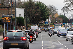 © Licensed to London News Pictures. 22/12/2020. London, UK. Queues of traffic on the South Circular near Putney, South West London as Christmas shoppers head out to the high street for last minute supplies and click & collect parcel pick ups. Yesterday a huge rush of shoppers descended on supermarkets causing long queues in the aisles and empty shelves after news of a French travel ban to Europe which blocked freight from leaving the Port of Dover after a spike of infections due to the Covid-19 mutation. Last week Prime Minister Boris Johnson put London and parts of the South East into Tier 4 lockdown after the new Covid-19 mutation was discovered. Photo credit: Alex Lentati/LNP