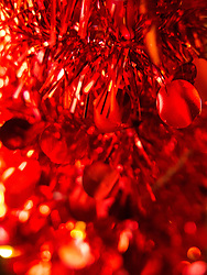 Red Sequins and Tinsel Christmas Decoration, Full Frame