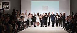 © Licensed to London News Pictures. 01/06/2015. London, UK. Graduate students on the catwalk at the end of the fashion show of Kingston University at Graduate Fashion Week 2015. Graduate Fashion Week takes place from 30 May to 2 June 2015 at the Old Truman Brewery, Brick Lane. Photo credit : Bettina Strenske/LNP