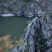 The Douro river slowly flowing in the narrow cliffs by the Mirandese Plateau.
