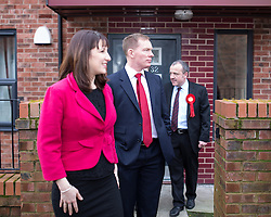 © Licensed to London News Pictures . 04/02/2014 . Sale , UK . L-R Rachel Reeves , Chris Bryant and Mike Kane leave Tony Gunning's flat . Rachel Reeves , MP for Leeds West and Shadow Secretary of State for Work and Pensions and Chris Bryant , MP for Rhondda and Shadow Minister for Welfare Reform , join Labour candidate Mike Kane on the campaign trail ahead of the Wythenshawe and Sale East by-election , following the death of MP Paul Goggins . They visit the home of Tony Gunning (51) who suffers from hereditary adult polycystic kidney disease and is on dialysis , who says he is affected by the bedroom tax . Photo credit : Joel Goodman/LNP