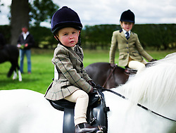 © Licensed to London News Pictures.29/07/15<br /> Borrowby, UK. <br /> <br /> A young rider sits on his horse as he waits to enter the main arena for his round of competition at the Borrowby Country Show and Gymkhana in North Yorkshire.<br /> <br /> Photo credit : Ian Forsyth/LNP